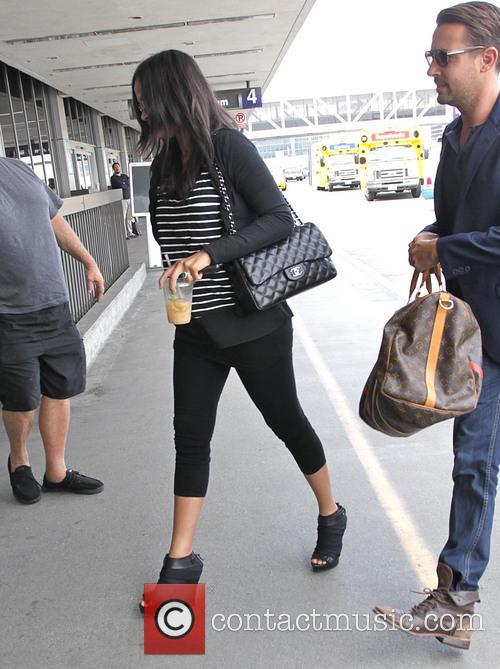 Zoe Saldana arrives at Los Angeles International Airport...