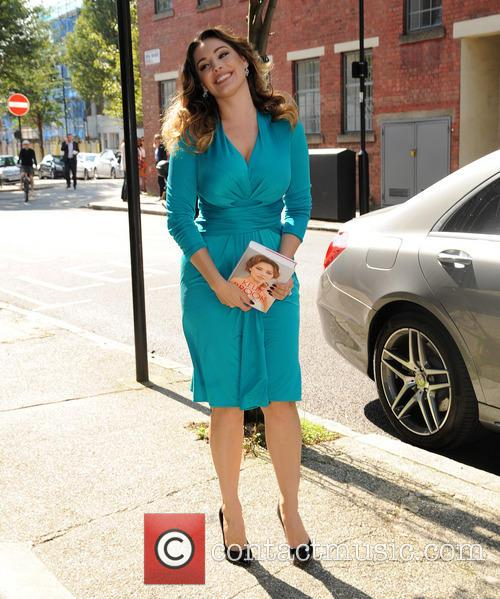 Kelly Brook arrives at her publishing company