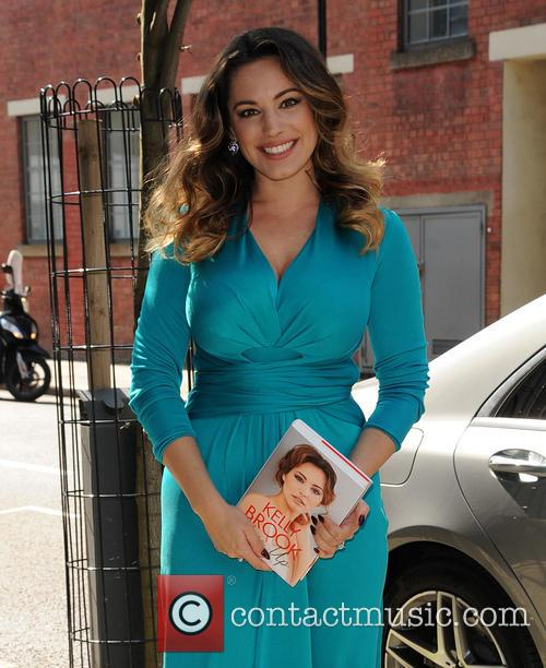 Kelly Brook arrives at a publishing house