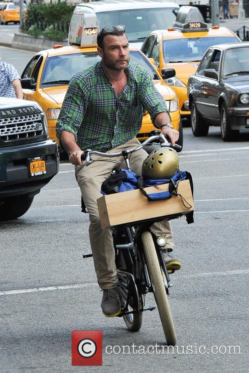 Liev Schreiber bike riding through New York City