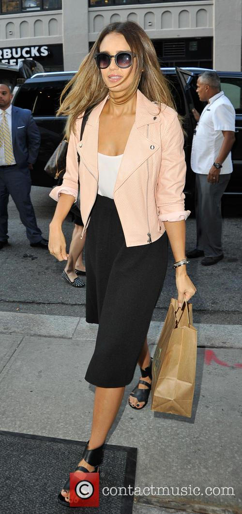 Jessica Alba returns to her hotel in New...