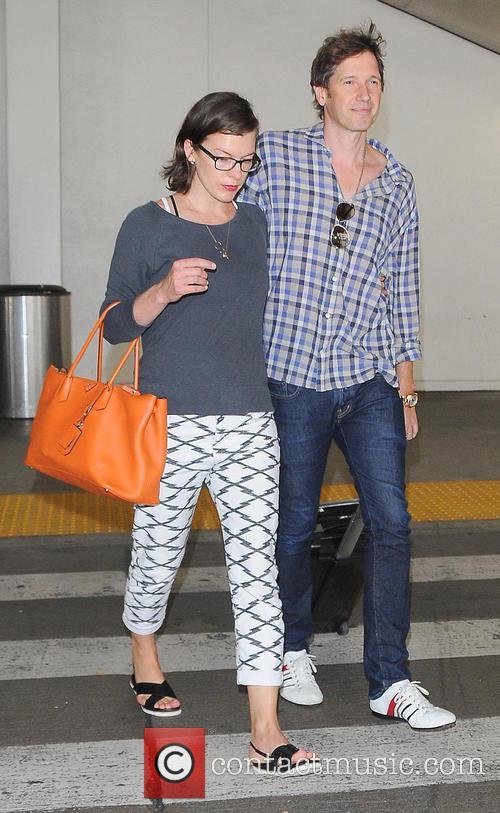 Milla Jovovich and husband Paul Anderson at Los...