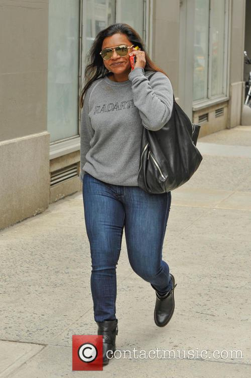 Mindy Kaling sports a Radarte Sweatshirt, with a...