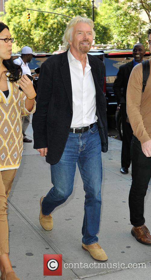 Sir Richard Branson walking with friends in Tribeca