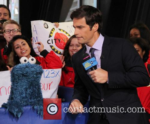 Cookie Monster and Rob Marciano  Weather Host 6