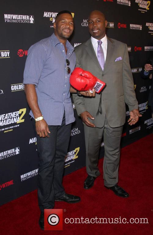 Michael Strahan and Lennox Lewis 5