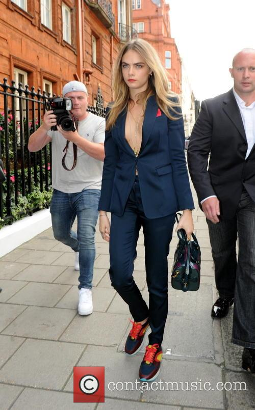 Kate Moss and Cara Delevingne arrive at a...