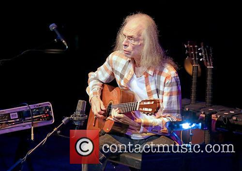 Steve Howe, of the band Yes, performs at...