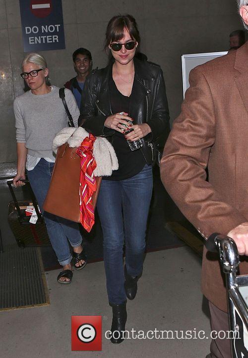 Dakota Johnson arrives at Los Angeles International (LAX)...