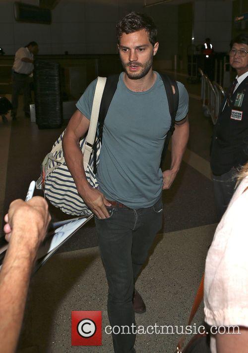 Jamie Dornan arrives at Los Angeles International (LAX)...