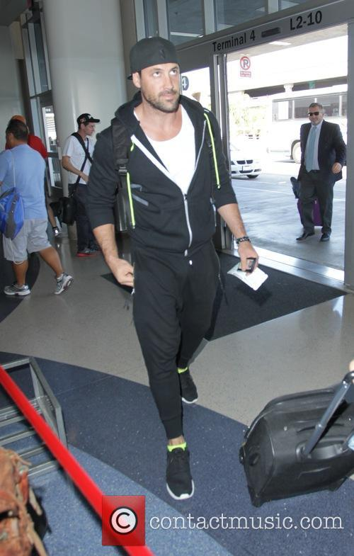Maksim Chmerkovskiy leaving Los Angeles International Airport