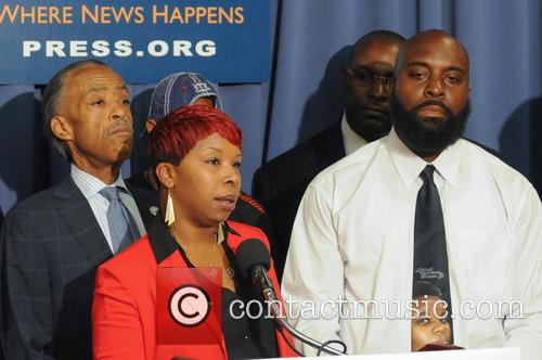 Civil rights leaders join the families of Michael...