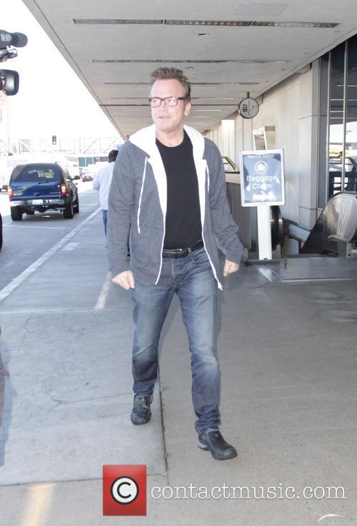 Tom Arnold leaving Los Angeles International Airport