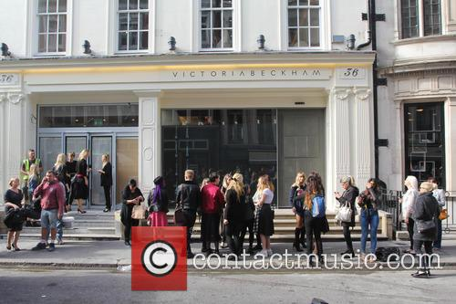 Shoppers queue outside Victoria Beckham's new London store