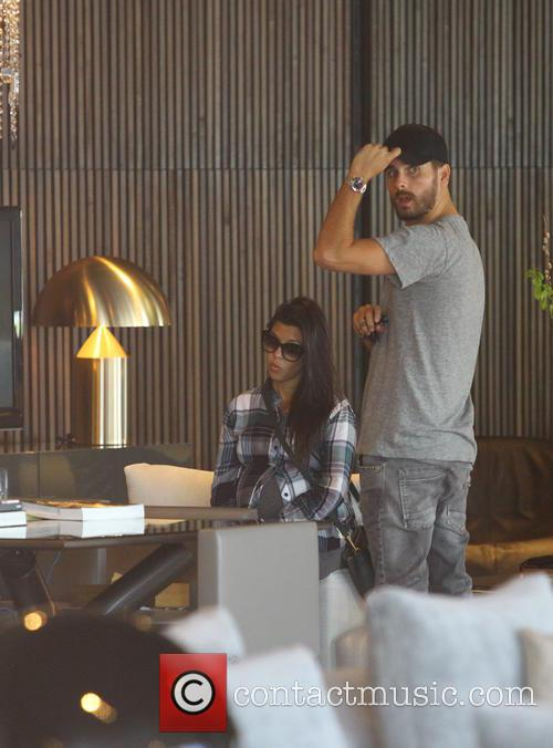 Pregnant Kourtney Kardashian and Scott Disick shop for...