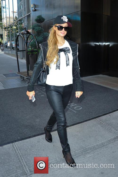 Paris Hilton spotted leaving the Trump Soho New...