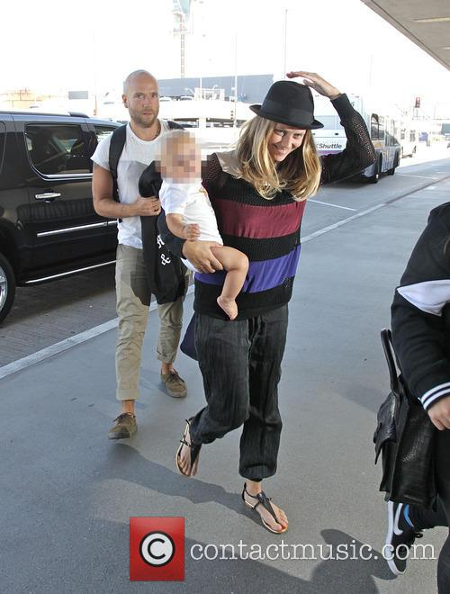 Teresa Palmer and Mark Webber with their baby...