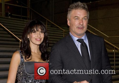 Alec Baldwin and his wife attend the premiere...
