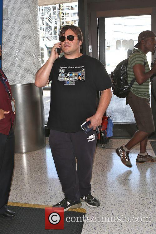 Jack Black pretends to be on phone like...