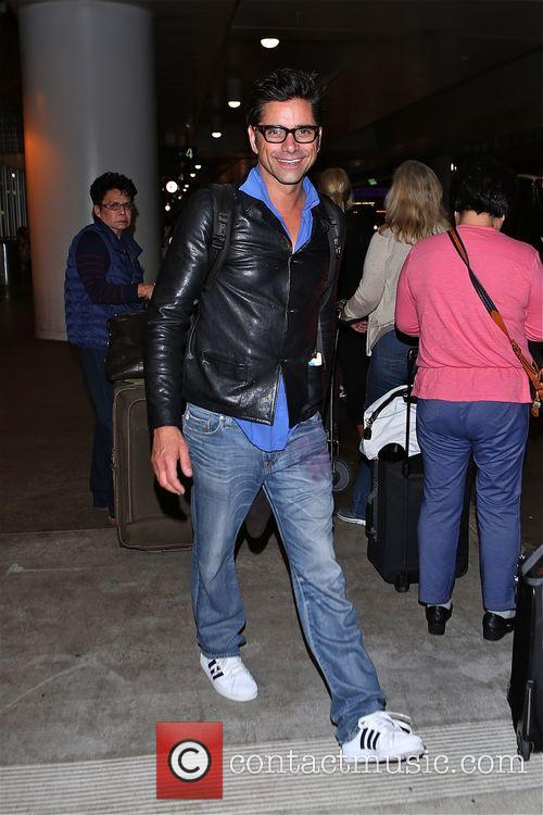 John Stamos arrives at Los Angeles International Airport
