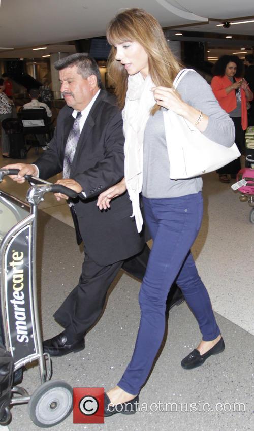 Jennifer Flavin arrives at Los Angeles International Airport