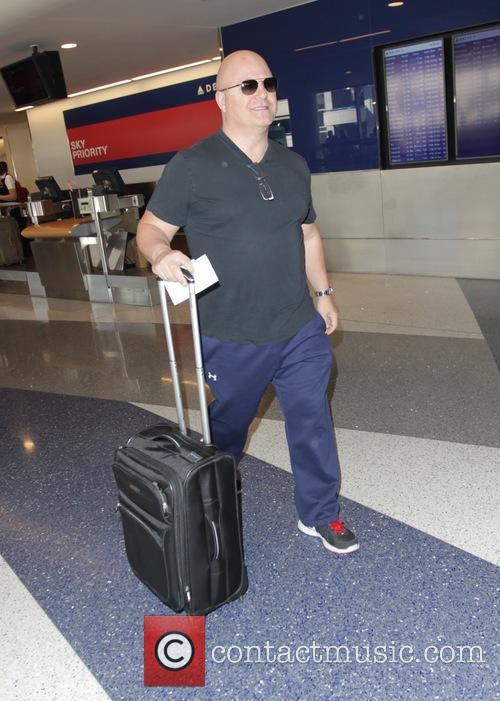 Michael Chiklis leaves Los Angeles International Airport