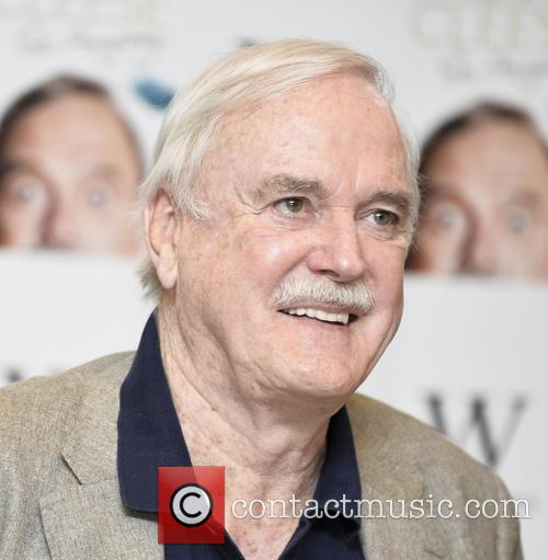 John Cleese promotes and signs copies of his...