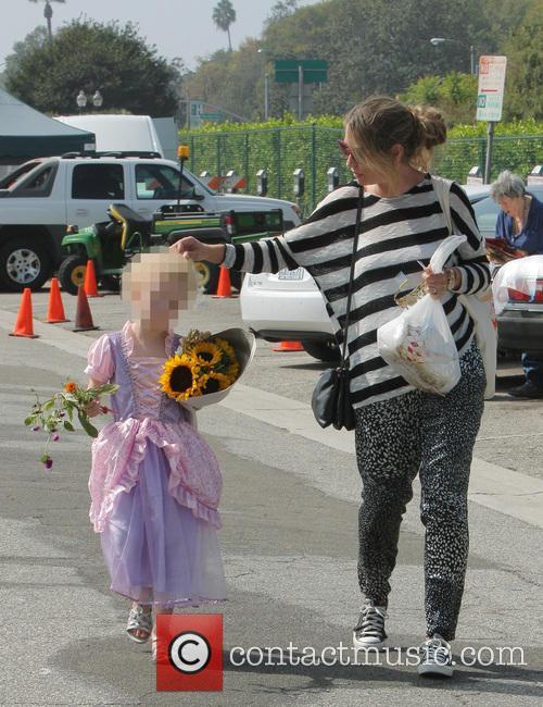 Eric Dane and Rebecca Gayheart take their daughters...