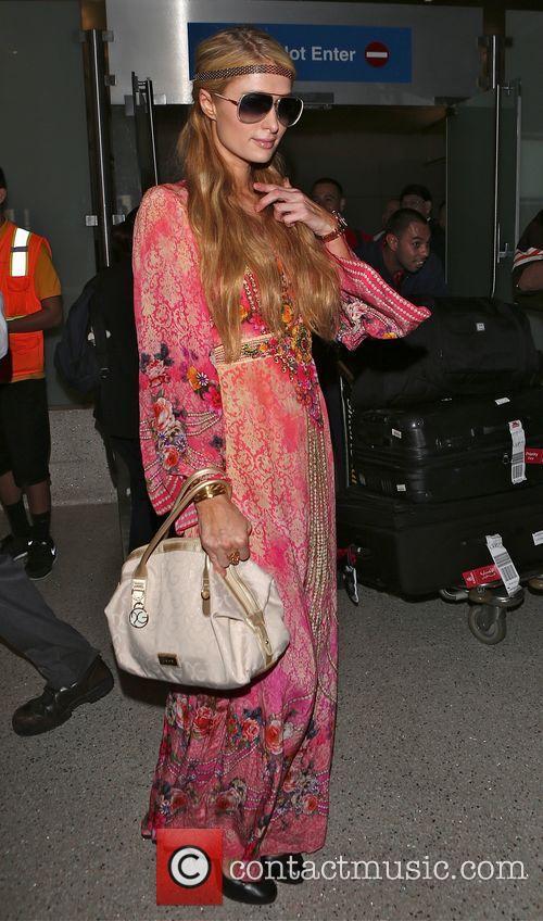 Paris Hilton arrives at Los Angeles International (LAX)...