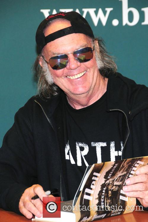 Neil Young signs copies of his book 'Special...