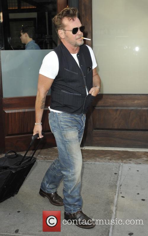 John Mellencamp leaves his hotel in New York