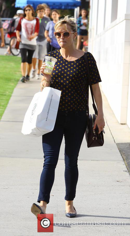 Reese Witherspoon appears in good spirits on a...