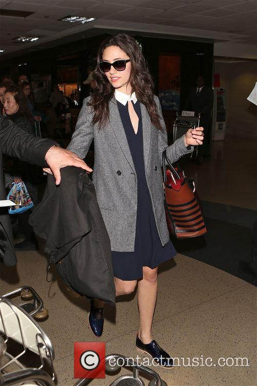 Emmy Rossum arrives at Los Angeles International Airport...