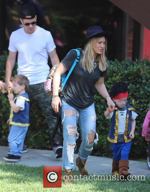 Hilary Duff, Mike Comrie, and their son Luca...