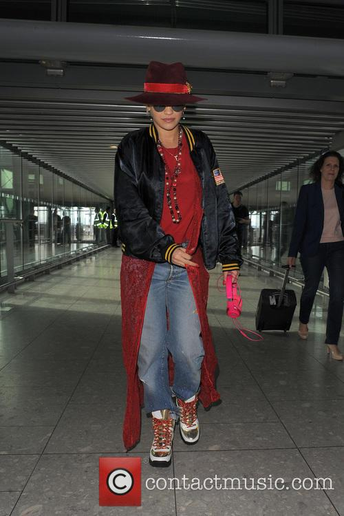 Rita Ora leaves her home and heads to...