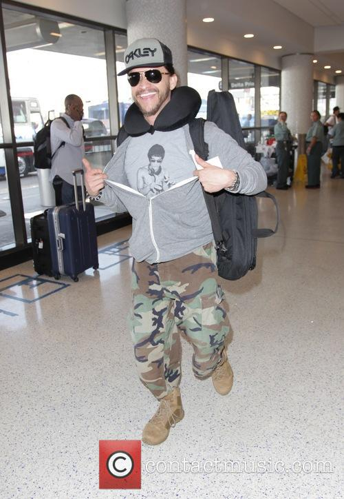 Clifton Collins Jr. departs Los Angeles International Airport