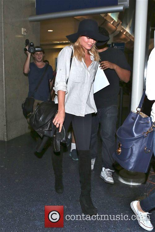 Actress Margot Robbie arrives at LAX airport