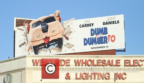 A poster board features an advertisement for 'Dumb...