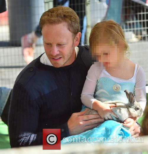 Ian Ziering and his two daughters play with...