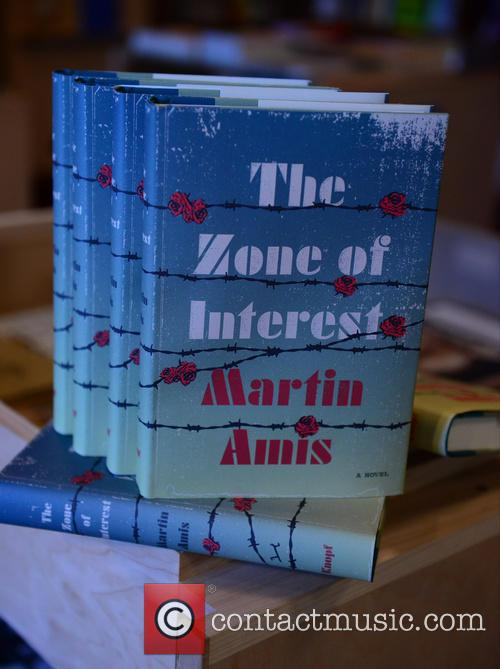 Martin Amis signs copies of his book