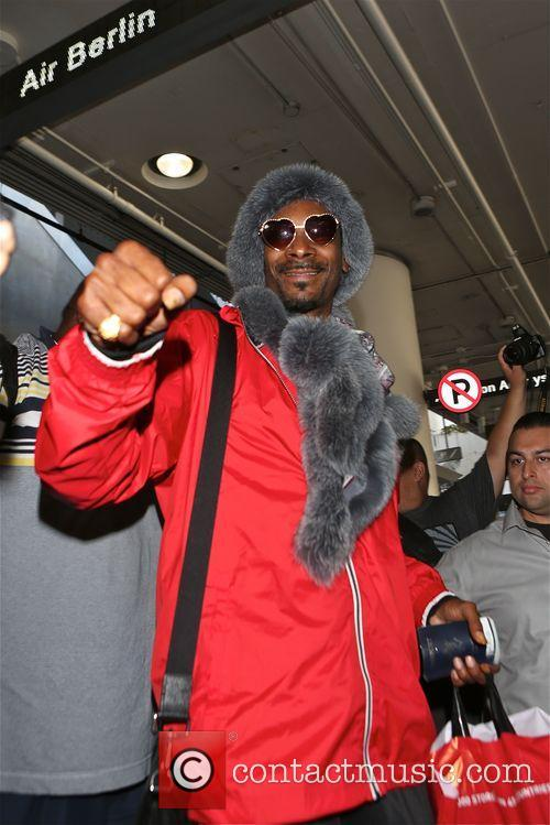 Snoop Dogg arrives at Los Angeles International Airport
