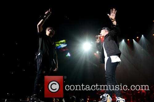 Enrique Iglesias and Pitbull perform at the American...