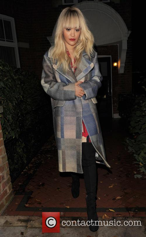 Rita Ora leaving her house wearing a patterned...