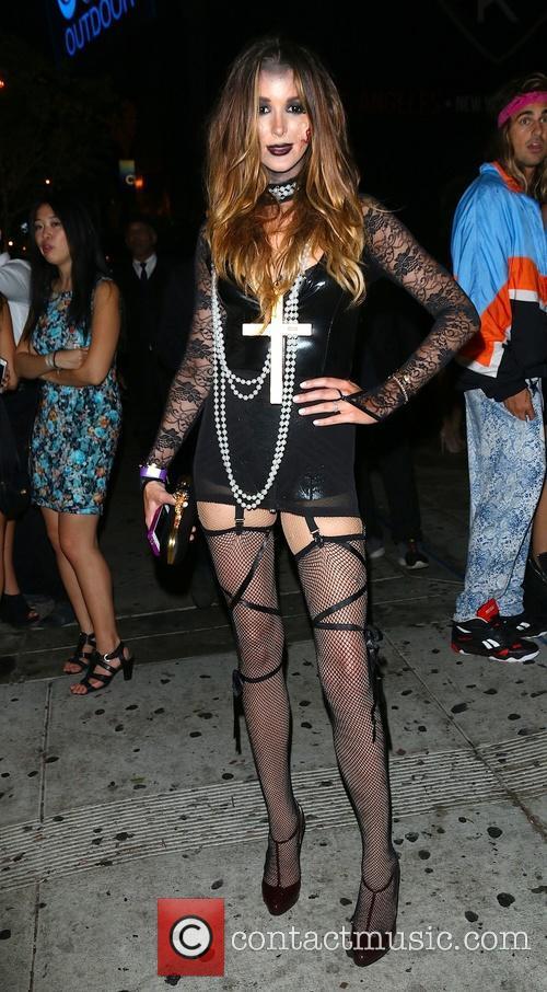 Celebrities dressed in Halloween costumes outside 1 Oak...