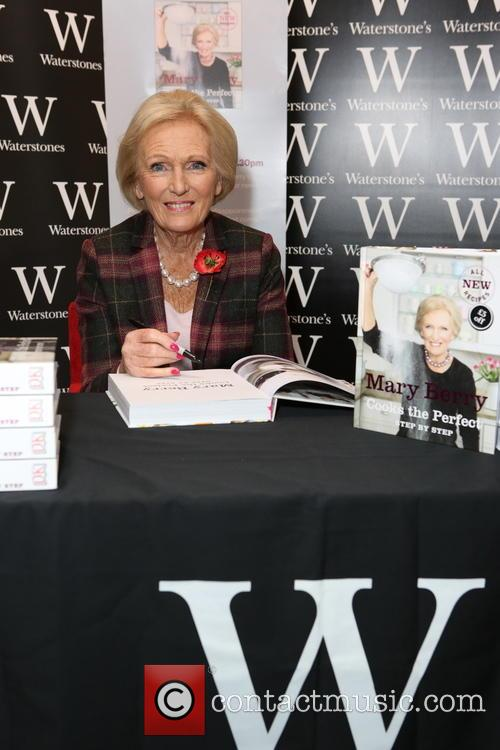 Mary Berry signs copies of her new cookbook...