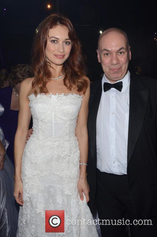 Olga Kurylenko and John Taylor 9