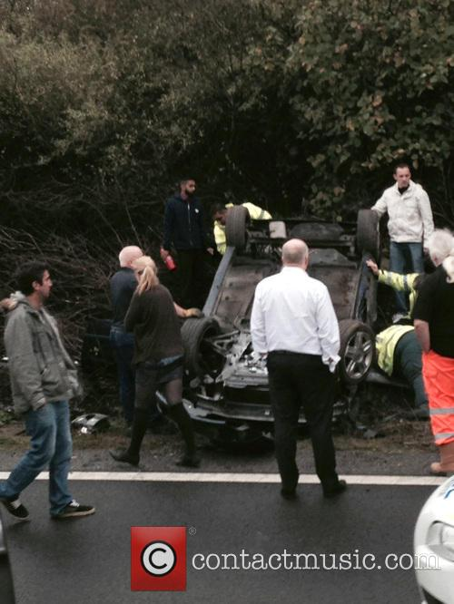 A car is overturned on the M1-M25 Chiswell...