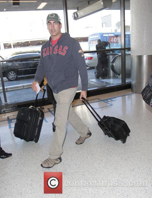 Rob Riggle departs Los Angeles International Airport