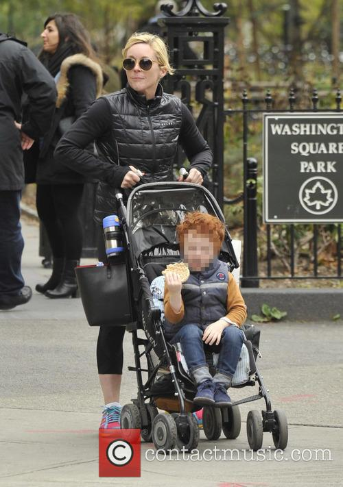 Jane Krakowski and her son out for a...