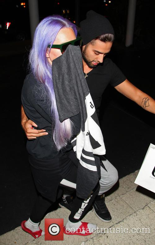 Amanda Bynes acts camera shy as she arrives...